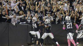 Pryor y Woodson dan triunfo a Raiders
