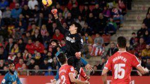 El empuje de Diego Costa salva un punto para el Atlético en Girona