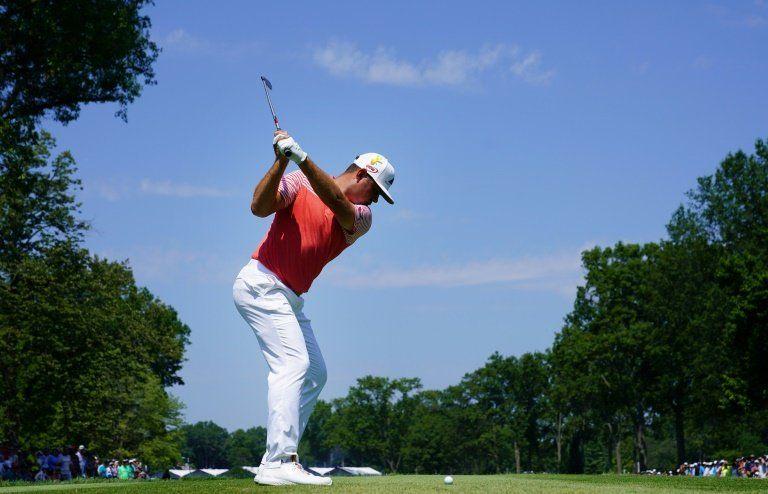 Woodland lidera y Rahm se acerca en Campeonato de la PGA alterado por tormenta