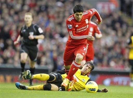 Suarez given 1-match ban for obscene gesture